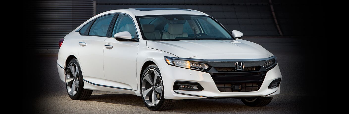 Exterior view of white 2018 Honda Accord parked inside a warehouse