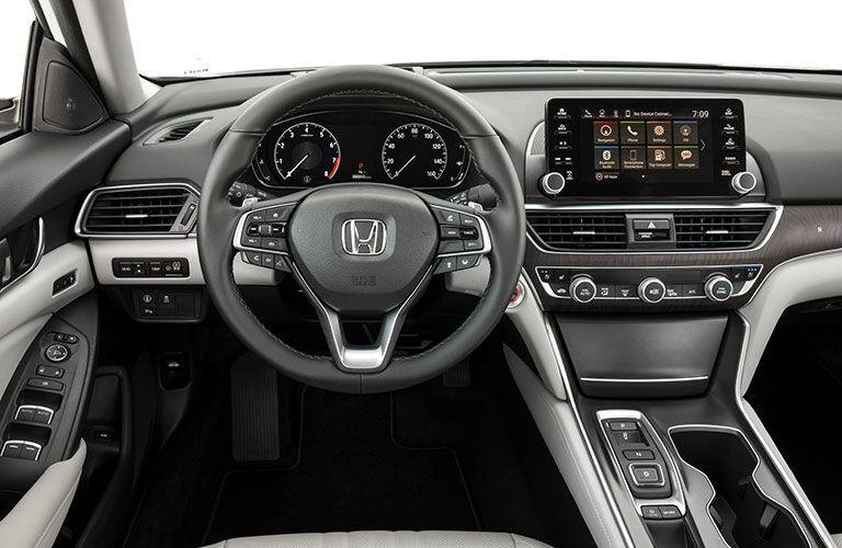 Interior view of 2018 Honda Accord showing steering wheel with paddle shifters and infotainment system