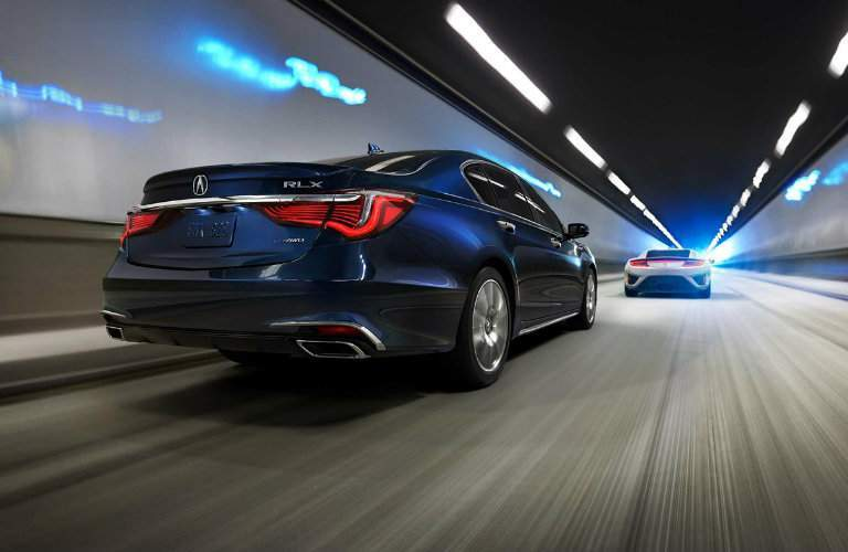 2018 Acura RLX Sport Hybrid SH-AWD in tunnel following an NSX