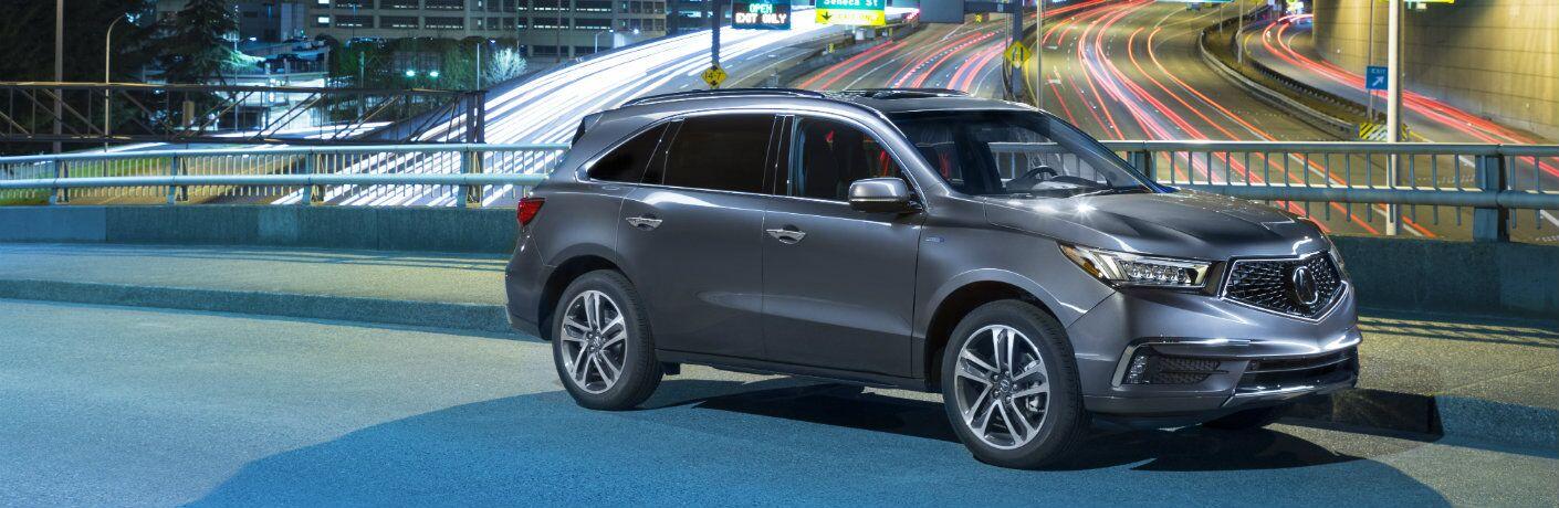 2019 Acura MDX Sport Hybrid SH-AWD parked on bridge