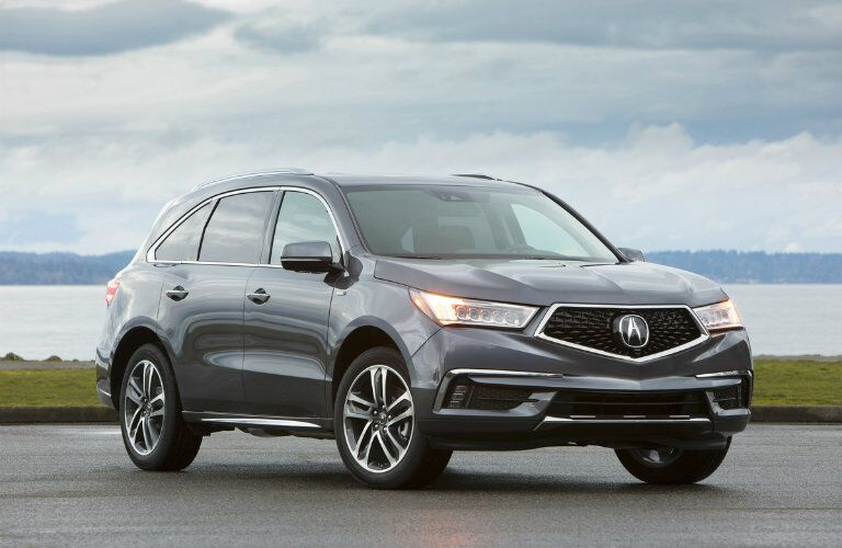 2019 Acura MDX Sport Hybrid SH-AWD parked in front of lake