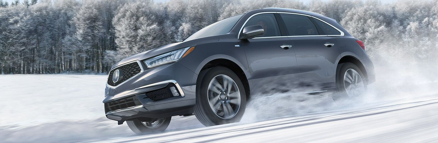 2019 Acura MDX driving through snow