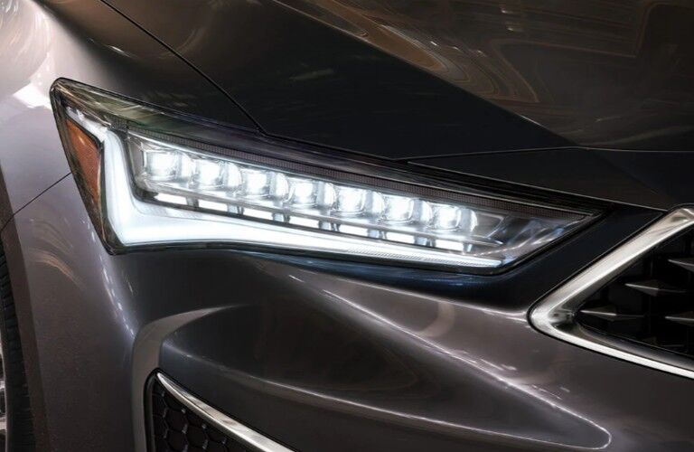 Close up of the passenger side headlight on a gray 2020 Acura ILX