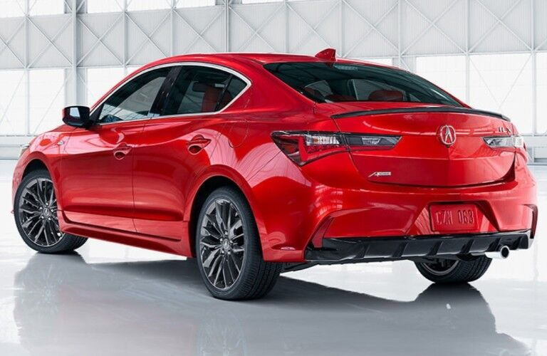 Rear driver angle of a red 2020 Acura ILX