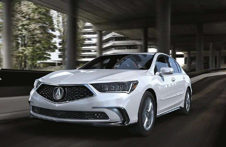 Front driver angle of a white 2020 Acura RLX driving on a road
