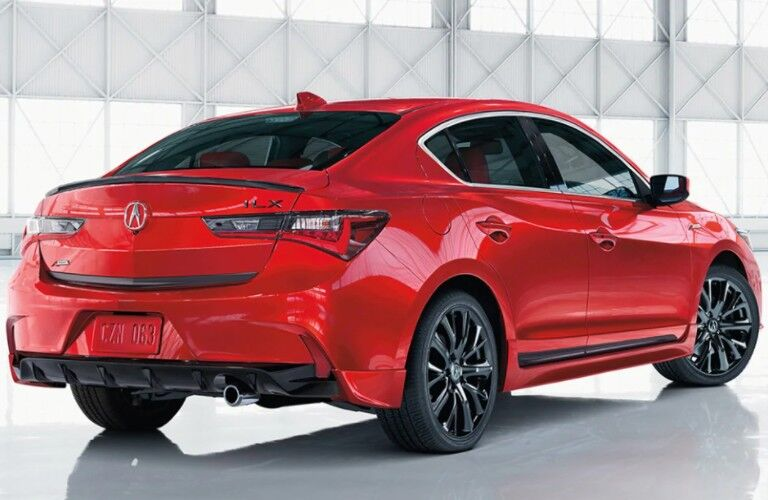 Rear passenger angle of a red 2021 Acura ILX A-Spec with Premium Package