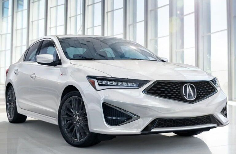 Front passenger angle of a white 2021 Acura ILX A-Spec with Technology Package