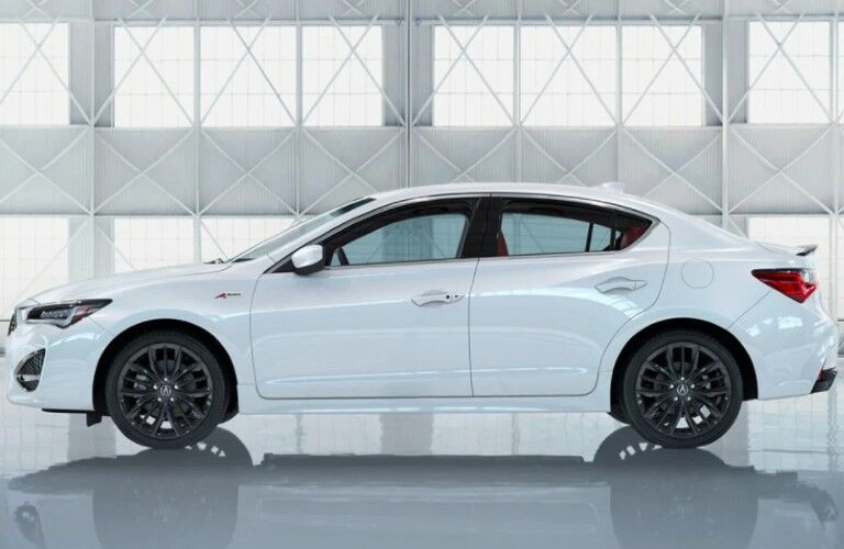 Driver angle of a white 2021 Acura ILX A-Spec with Technology Package