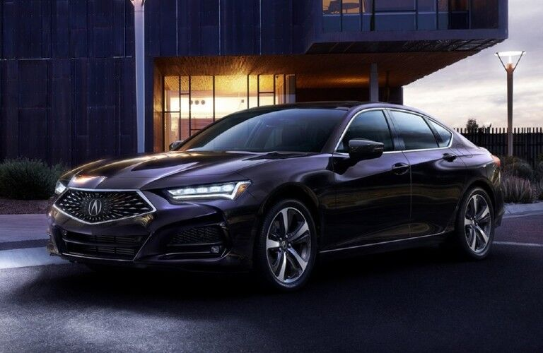 Front driver angle of a dark grey 2021 Acura TLX Advance Package