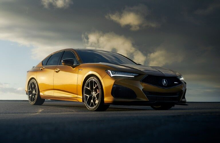 Front passenger angle of a gold 2021 Acura TLX Type S