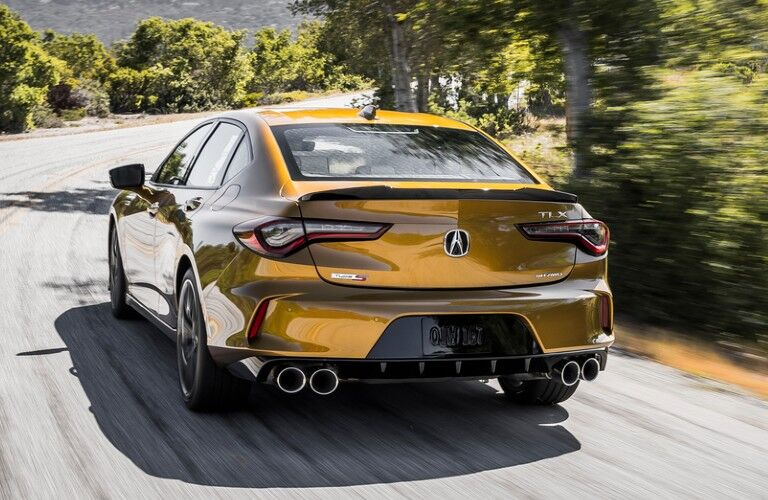 Rear driver angle of a gold 2021 Acura TLX Type S