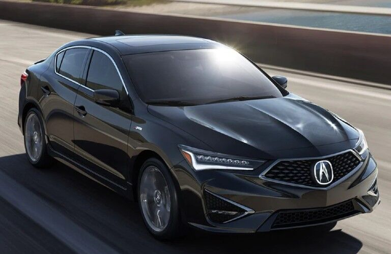 Front passenger angle of a black 2022 Acura ILX