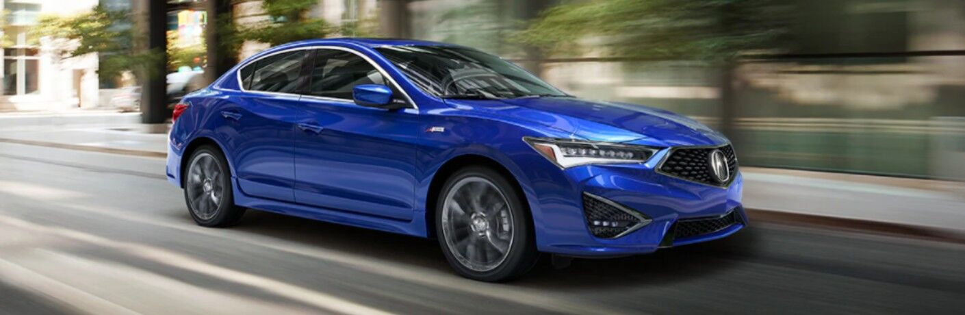 Front passenger angle of a blue 2022 Acura ILX