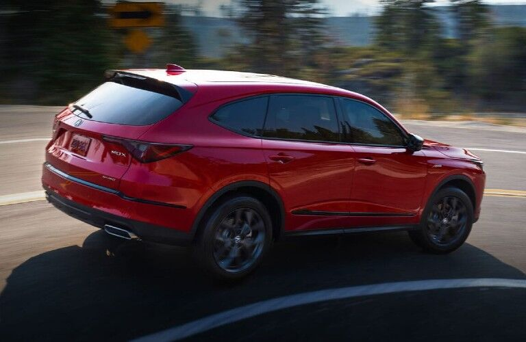 Rear passenger angle of a red 2022 Acura MDX