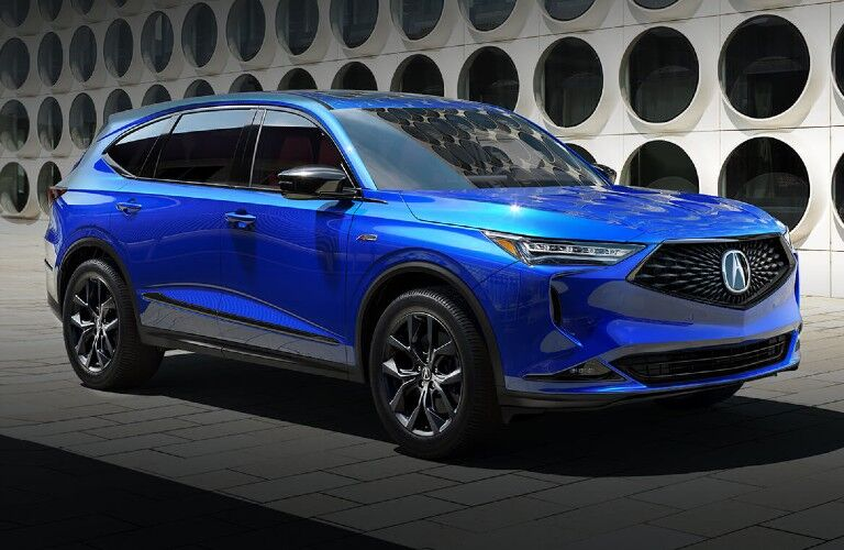 Front passenger angle of a blue 2022 Acura MDX A-Spec Package