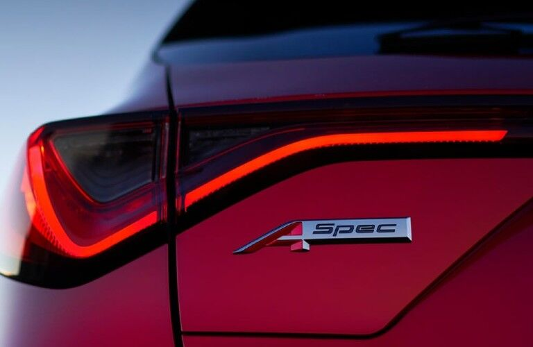A-Spec logo on the back of a red 2022 Acura MDX A-Spec Package