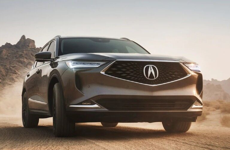 Front passenger angle of a grey 2022 Acura MDX Advance Package