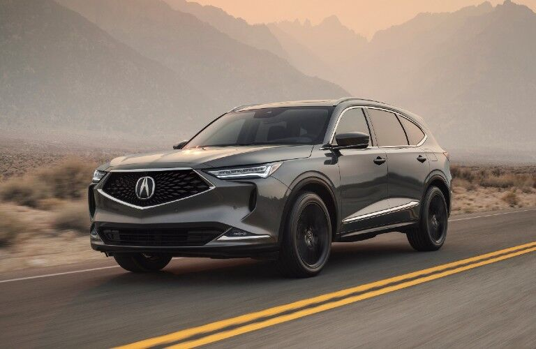Front driver angle of a grey 2022 Acura MDX