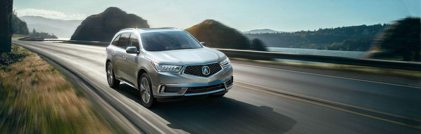 Silver 2018 Acura MDX Advance Package driving down highway