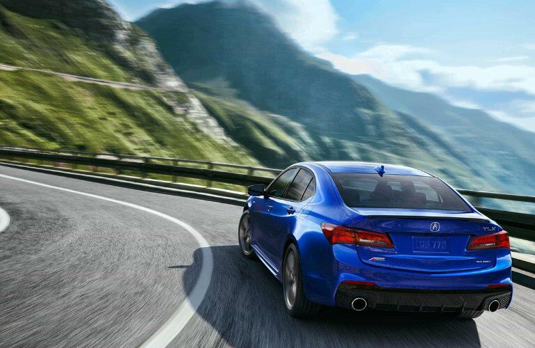 2018 Acura TLX Rear End Blue driving around curve