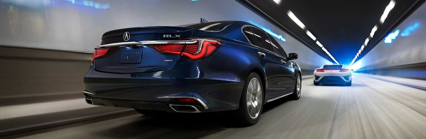 2019 Acura RLX in blue following an Acura NSX