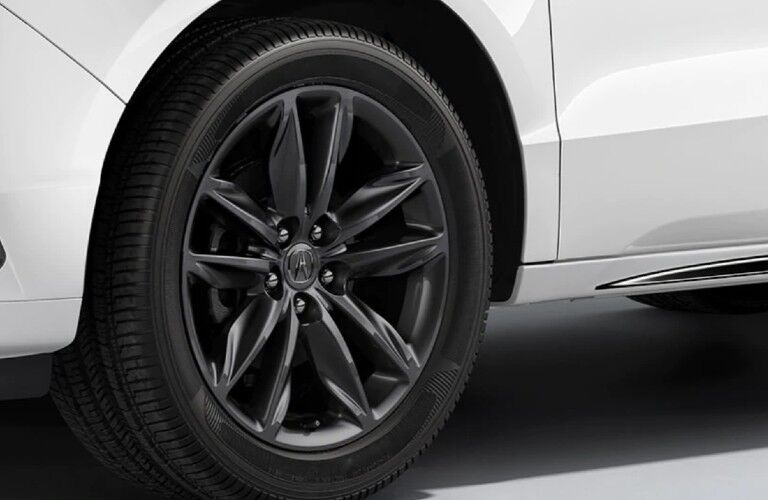 Close up of the Shark Grey wheel on a white 2020 Acura MDX A-Spec Package