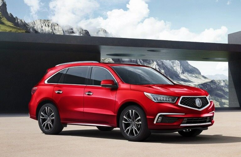 Front passenger angle of a red 2020 Acura MDX Advance Package