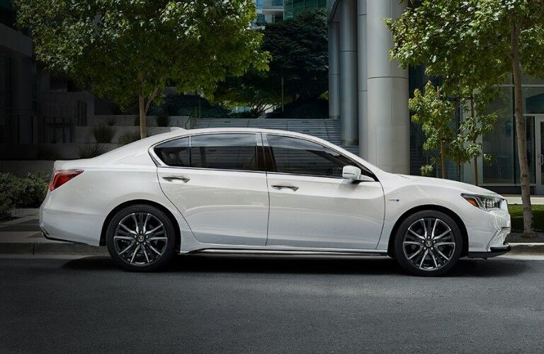 Passenger angle of a white 2020 Acura RLX parked on the side of the street