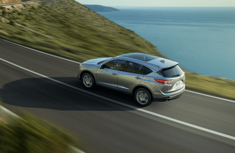 2020 Acura RDX driving by a body of water