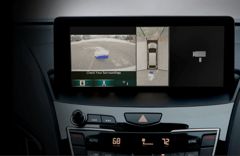 Close up of the display showing the rear camera and aerial view of the vehicle in the 2020 Acura RDX Advance Package