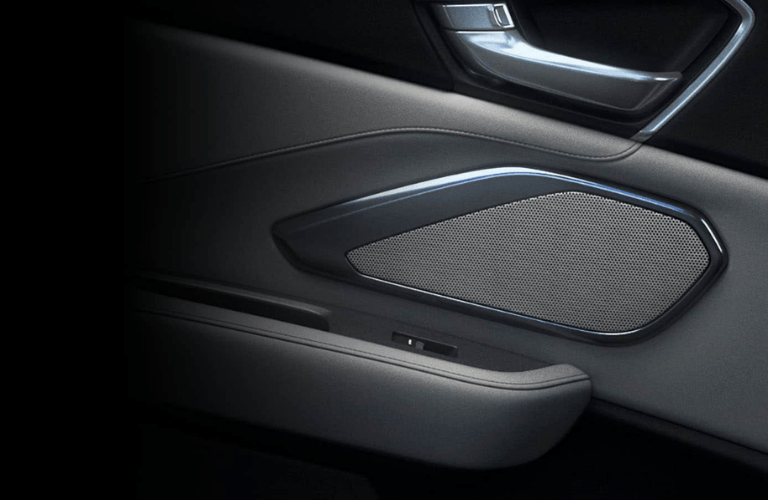 Close up of a speaker on the passenger side door in the 2020 Acura RDX Advance Package
