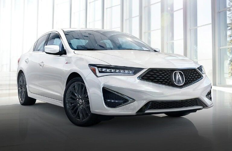 Front passenger angle of a white 2021 Acura ILX