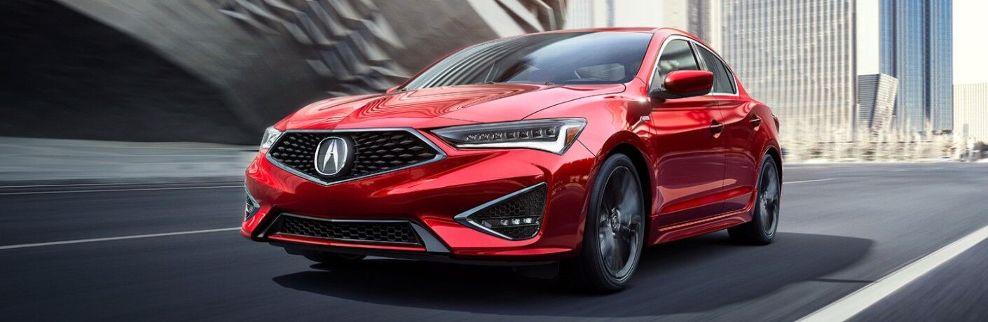 Front driver angle of a red 2021 Acura ILX