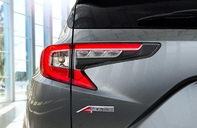 Close up of the A-Spec logo on the rear side of a grey 2021 Acura RDX