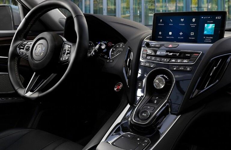 Steering wheel and entertainment system inside the 2021 Acura RDX