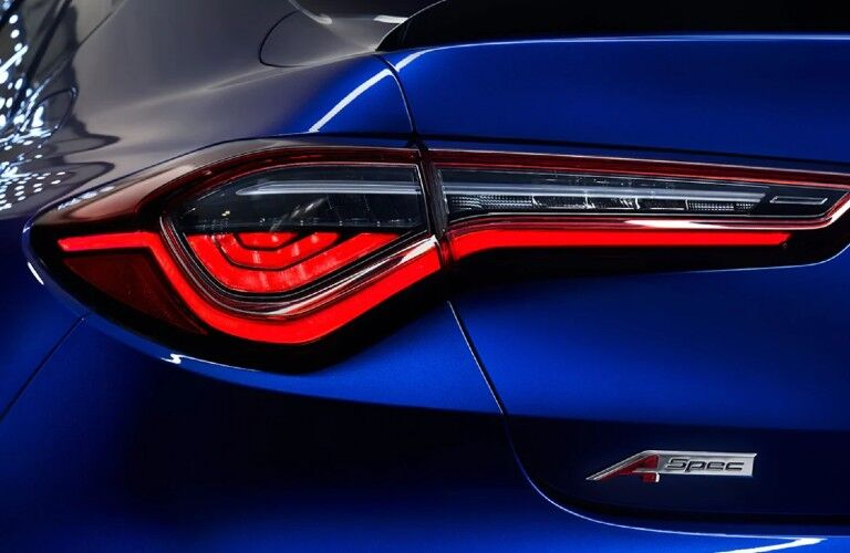 Close up of the rear driver taillight and A-Spec logo on a blue 2021 Acura TLX A-Spec Package