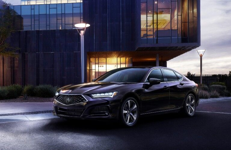 Front driver angle of a dark-colored 2021 Acura TLX