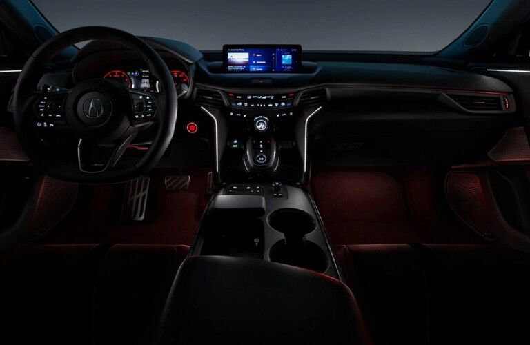 Front interior in the 2021 Acura TLX with red ambient lighting