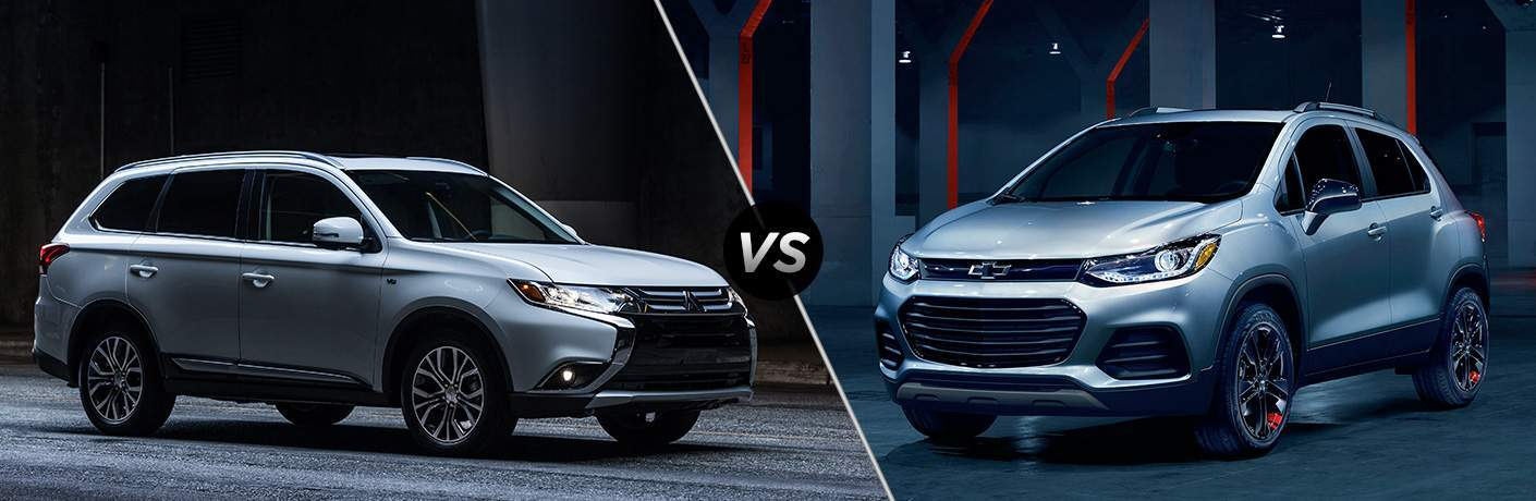 A nose-to-nose comparison photo of the 2018 Outlander vs. 2018 Trax.