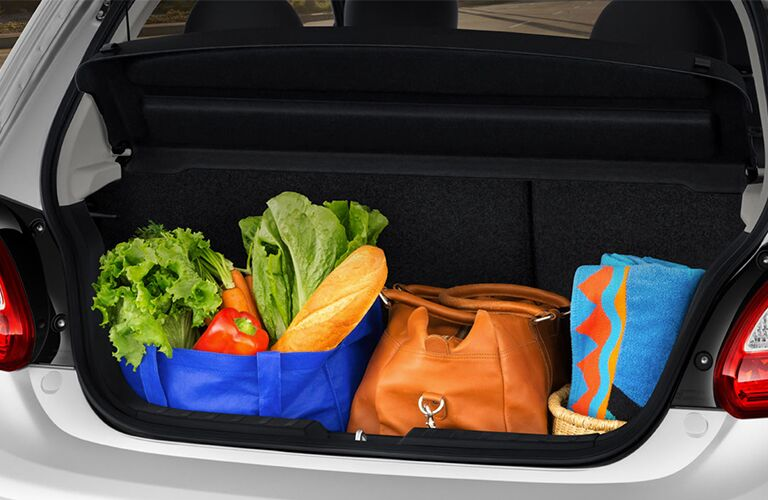 A photo showing how much cargo can fit in the back of the 2018 Mitsubishi Mirage with the rear seats deployed.