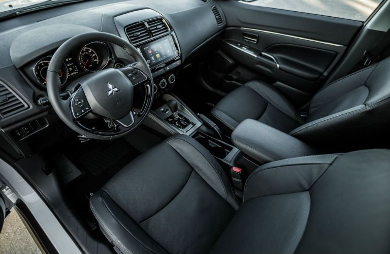An interior photo showing the driver's cockpit in the 2018 Mitsubishi Outlander Sport.