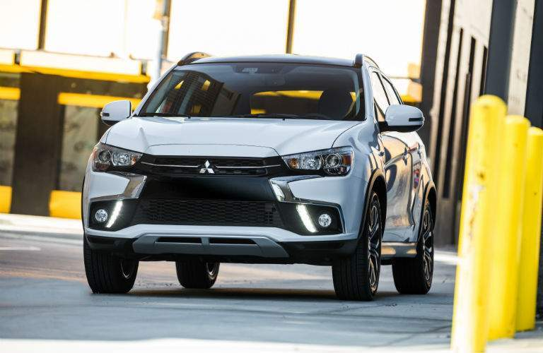 A head-on photo of the 2018 Mitsubishi Outlander Sport parked on the street.