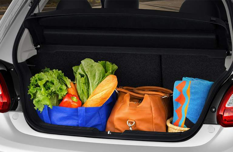 A photo of the rear of the 2018 Mitsubishi Mirage packed with groceries