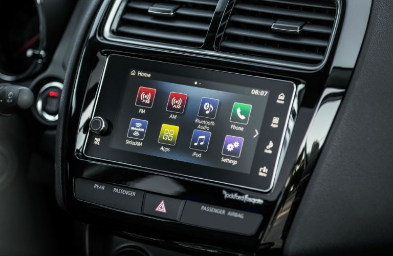 A close up photo of the touchscreen interface in the 2018 Outlander Sport.
