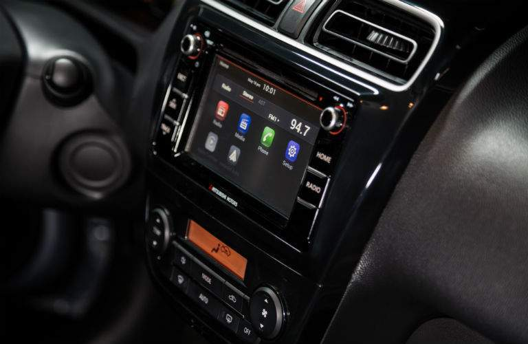 A close up photo of the infotainment system's touchscreen for the 2018 Mitsubishi Mirage G4