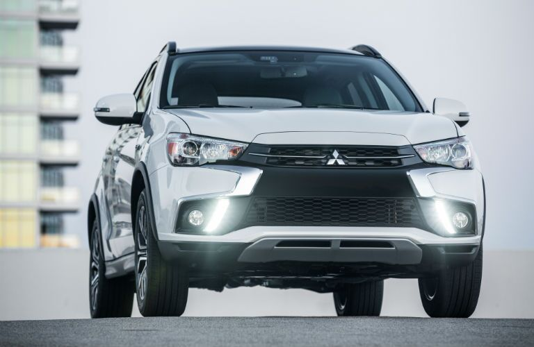 A head-on photo of the 2018 Mitsubishi Outlander Sport parked on a roof.