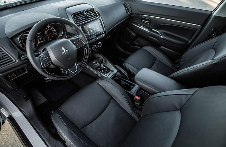 A top down view of the drive and front passenger seats in the 2018 Mitsubishi Outlander Sport as well as the center gauge cluster and gear shifter