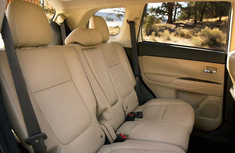 An interior photo of the 2018 Outlander showing its third-row seating.