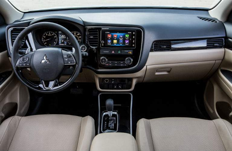 A photo showing the feature-packed dashboard in the front of the 2018 Outlander.