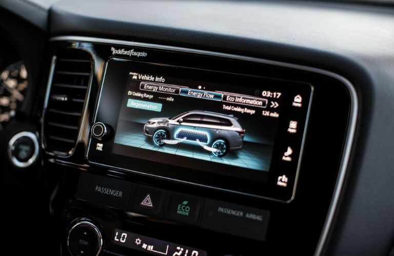 A close up photo of the touchscreen interface of the 2018 Outlander PHEV that can monitor fuel efficiency.